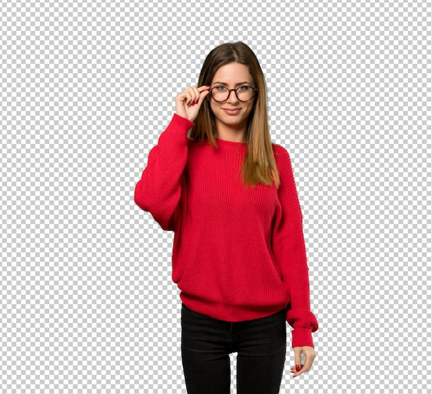 Young woman with red sweater with glasses and surprised