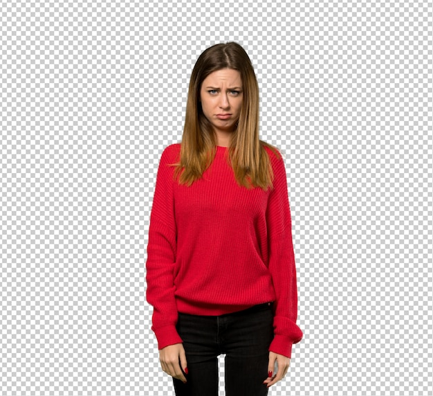 Young woman with red sweater with sad and depressed expression