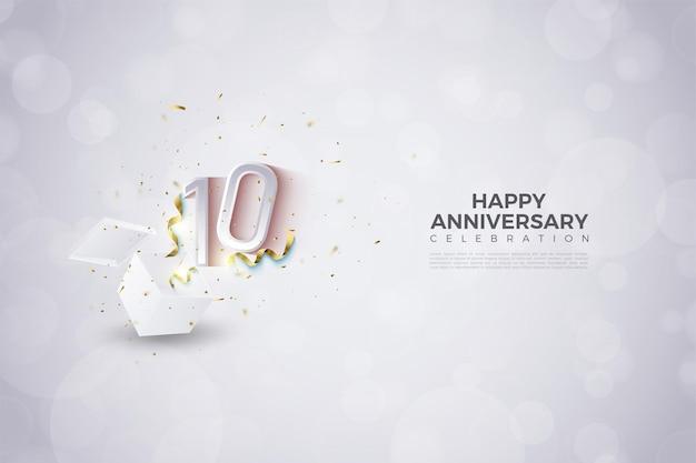 선물 상자에서 튀어 나온 숫자가있는 10 주년