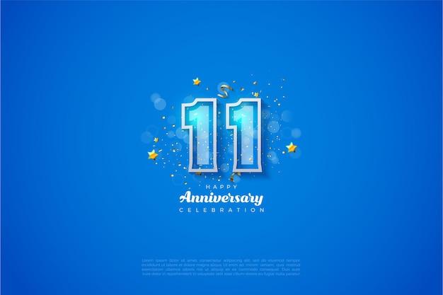 11-я годовщина с жирными цифрами в белой рамке на синем фоне.