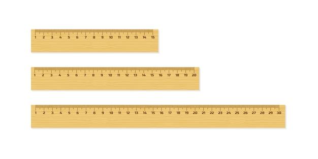 Набор деревянных правителей 15, 20 и 30 сантиметров с тенями, изолированных на белом. измерительный инструмент. школьные принадлежности