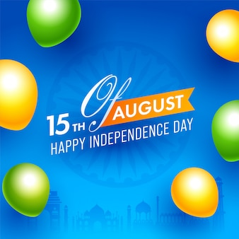 15th of august, happy independence day text on blue ashoka wheel background decorated saffron and green glossy balloons.