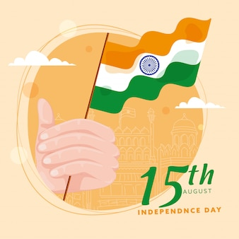 15th august independence day poster design with hand holding indian flag and line art red fort monument on pastel orange background.