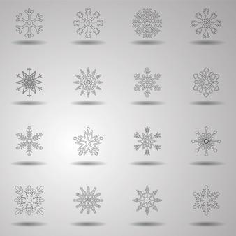 メリークリスマス。明けましておめでとうございます。 16個のクリスマススノーフレークアイコンのセット