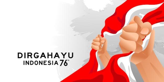 17 августа. открытка с днем независимости индонезии со сжатыми руками