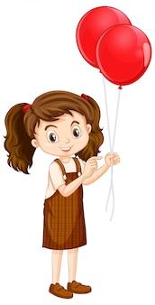 赤い風船を持つ1つの幸せな女の子