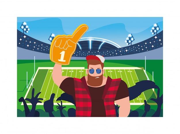 Мужчина держит перчатку с вентилятором номер 1, желтый палец пены на стадионе
