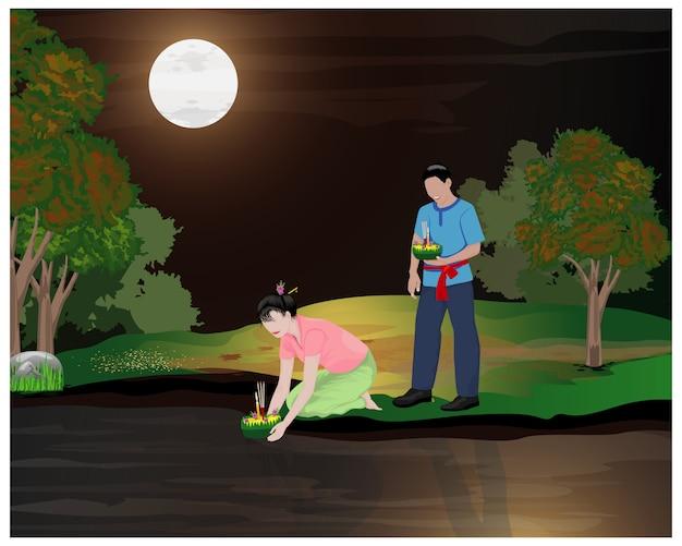 満月の下で2人の若いloy kratong