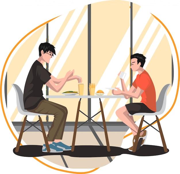 2人の若者がダイニングルームで一緒に朝食を食べています