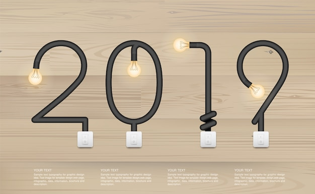 2019 - abstract light bulb on wood background.