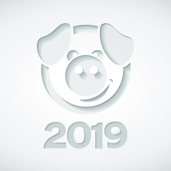 2019 and pig cut out of paper style.