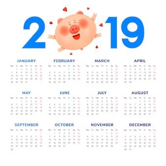 2019年のカレンダー。太った太った豚とハート色の数字