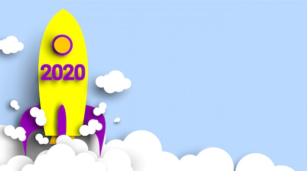 2020 new year number  with rocket in paper cut and craft style. symbol of achieve goals for 2020. start up company .