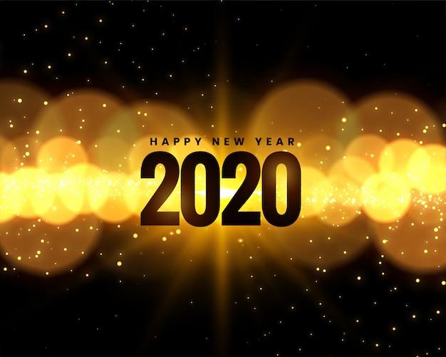 Празднование нового 2020 года с золотыми огнями боке
