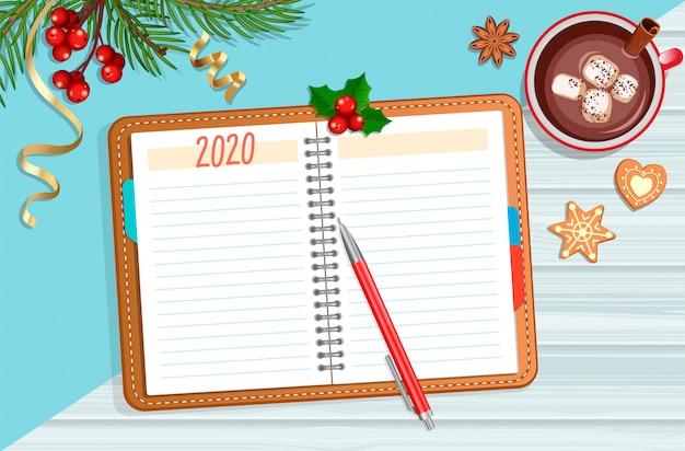 Планирование 2020 года с рождественскими аксессуарами.