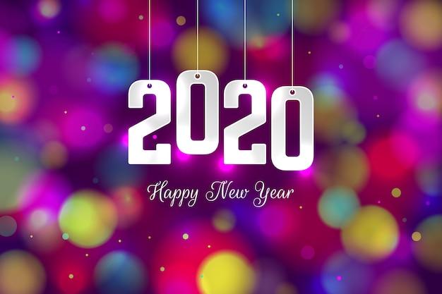カラフルなぼやけた新年2020年の背景