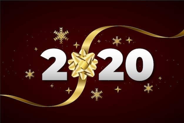 Реалистичная новогодняя открытка 2020 года с золотым подарочным бантом