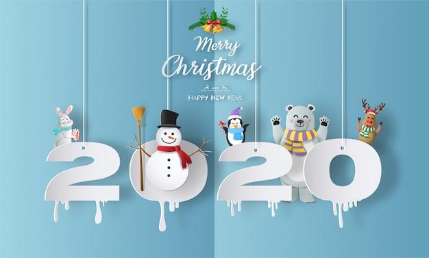 メリークリスマスと雪だるまと幸せな新年2020年コンセプト