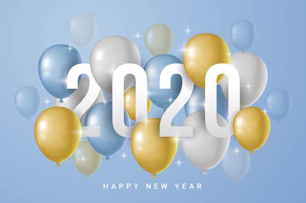 青色の背景に風船で幸せな新年2020