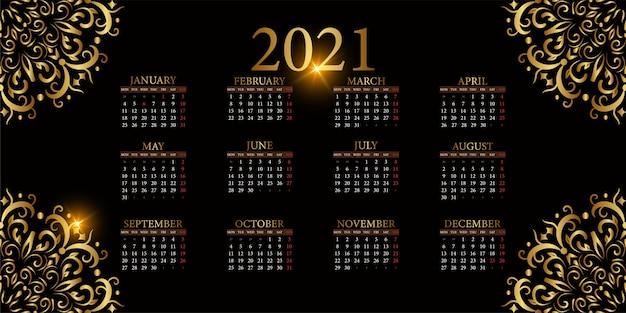 マンダラ飾りまたは花の背景デザインの2021年のカレンダー。