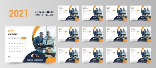 진한 파란색과 노란색 둥근 모양으로 2021 책상 달력 디자인