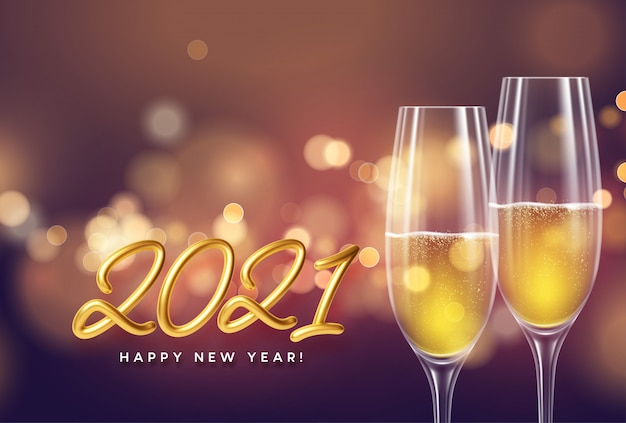 2021 golden lettering new year background with glasses of champagne and glowing bokeh light