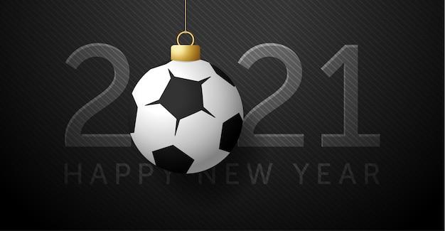 2021明けましておめでとう。フットボールまたはサッカーボールの背景。