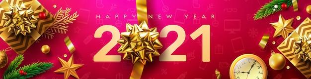 2021年明けましておめでとうございますバナーと金色のギフトボックスとクリスマスの装飾要素