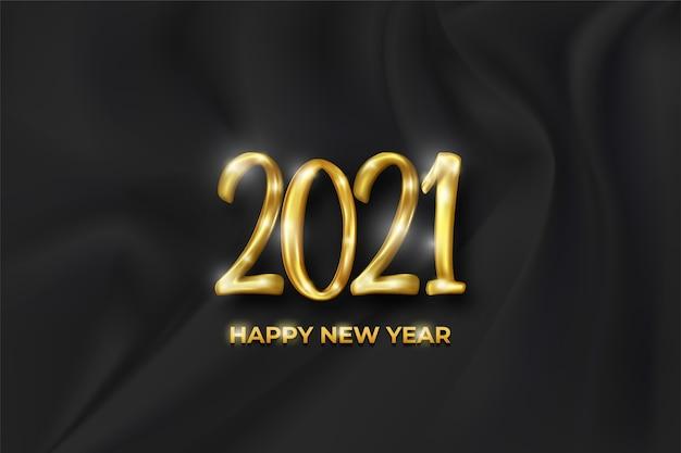 2021年賀状とシルク生地の背景に金色の数字。