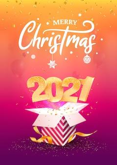 2021 새해 복 많이 받으세요. 메리 크리스마스 축하. 황금 숫자는 파란색 선물 상자 밖으로 날아