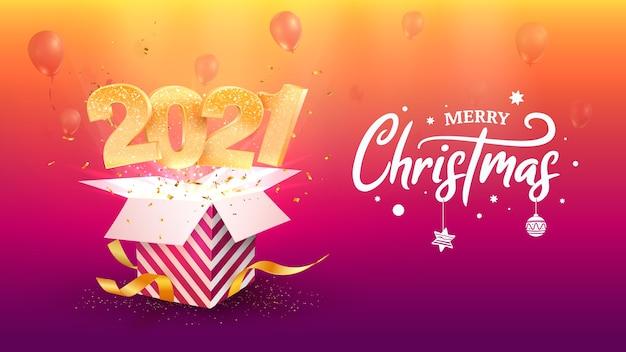 2021 새해 복 많이 받으세요. 메리 크리스마스 축하. 황금 숫자는 선물 상자 밖으로 날아