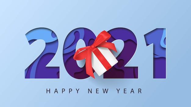 3dペーパーカットとギフトボックスの背景を持つ2021年明けましておめでとうございます
