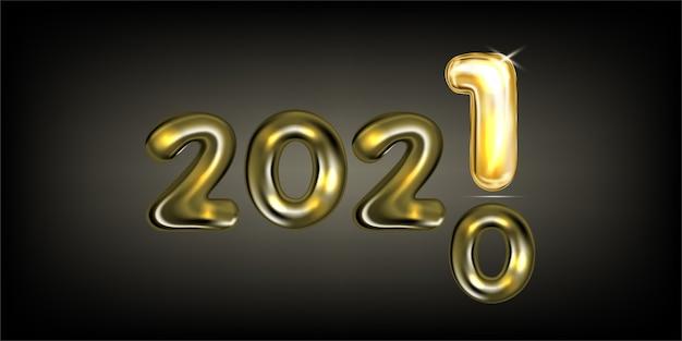 2021年の新年のグリーティングカードと金箔の風船のレタリング