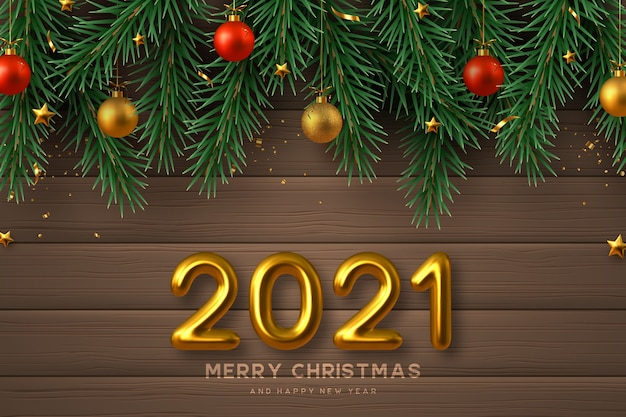 2021 new year sign. merry christmas background with realistic golden 3d numbers, gold and red balls, pine branches and stars. wooden background.