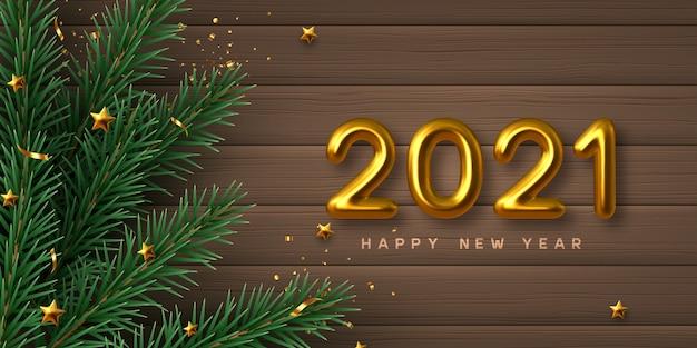 Новогодний знак 2021 года. с рождеством христовым фон с реалистичными золотыми 3d числами, сосновыми ветками и звездами. деревянный фон.
