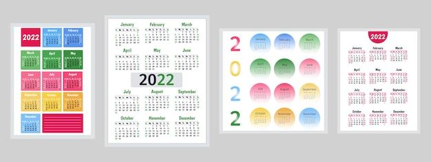 2022年のカレンダーセット。ベクトルテンプレートのコレクション。壁掛けカレンダー、グライダーを飾るためのシンプルなデザイン。週は日曜日に始まります。米国の休日が記載されています。ベクトルイラスト