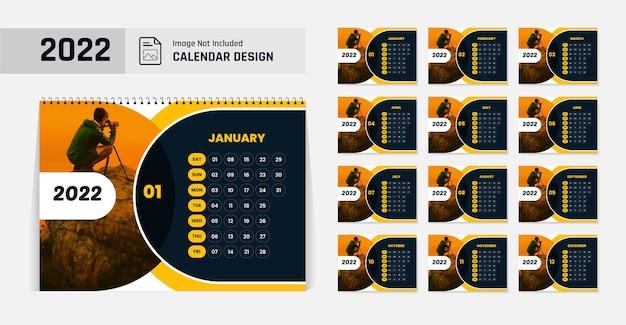 2022年新年の卓上カレンダーデザインテンプレート黄色と黒の色の形のモダンなレイアウト