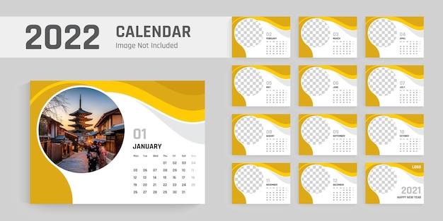 2022年新年の卓上カレンダーデザインテンプレート黄色の成形可能なレイアウト