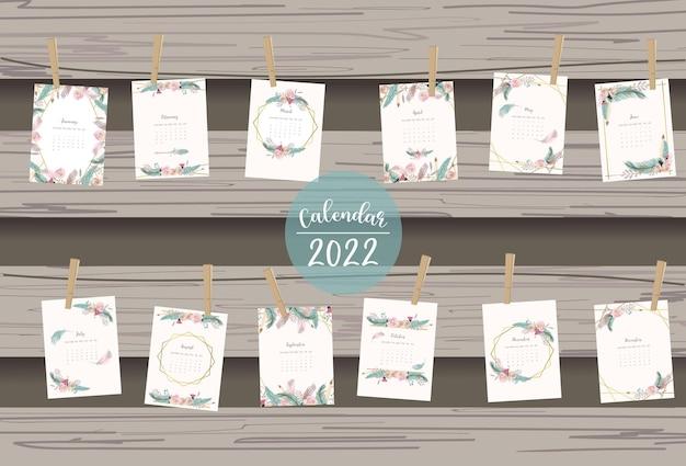 2022年のテーブルカレンダーの週は日曜日に羽と花で始まります