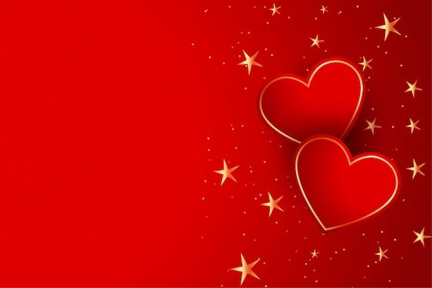 金色の星の背景を持つ2つの赤いハート