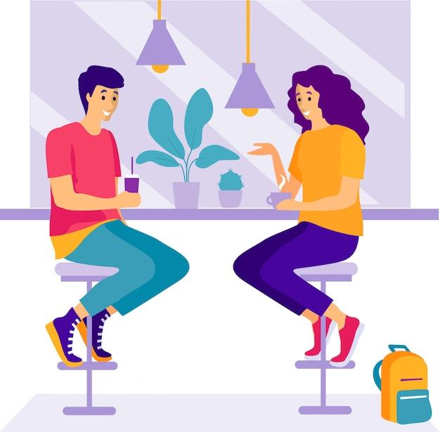 2人の女性がカフェに座って話します。