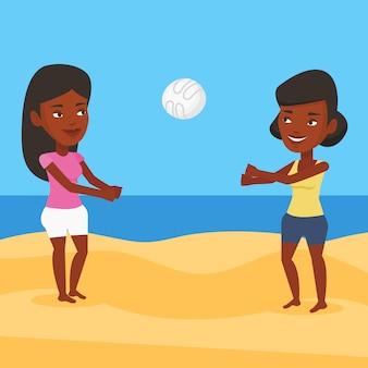 ビーチバレーボールをする2人の女性。