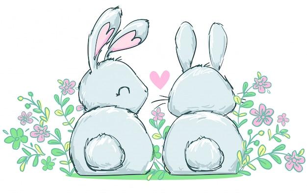 花、子供の美しいイラストに座っている2つのかわいいウサギ。