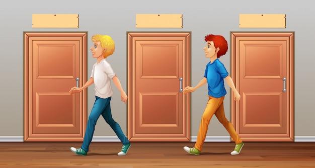 2人の男性が廊下を歩いています