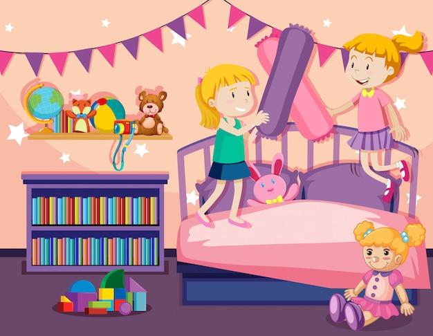 2人の女の子がベッドの上をジャンプ