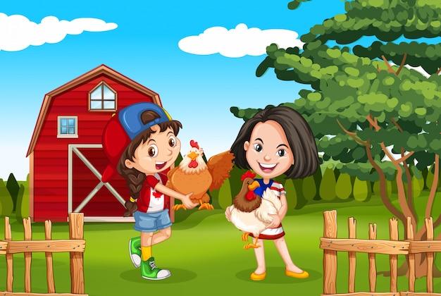 2人の女の子と農場の鶏