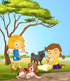 女の子と公園で2匹の犬