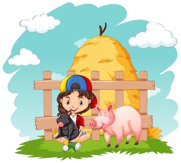 かわいい女の子と農場で2匹の豚
