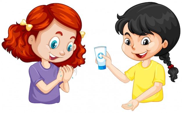 白い背景の上の手のゲルで手を洗っている2人の女の子