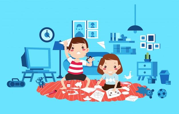 2人の子供の男の子と女の子のおもちゃでいっぱいのリビングルームで遊ぶ、子供たちは紙を切ると紙飛行機のイラストを作る